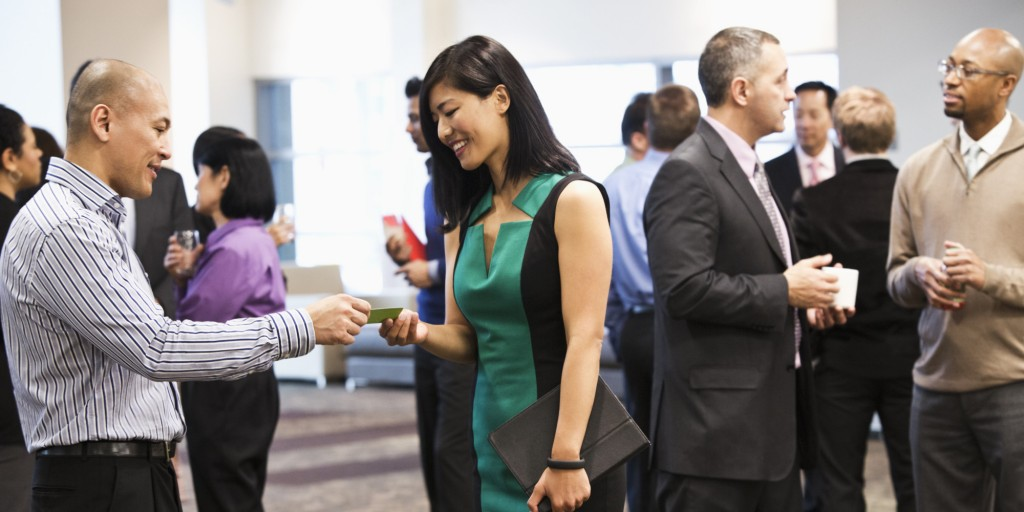Exchanging business cards at networking event.